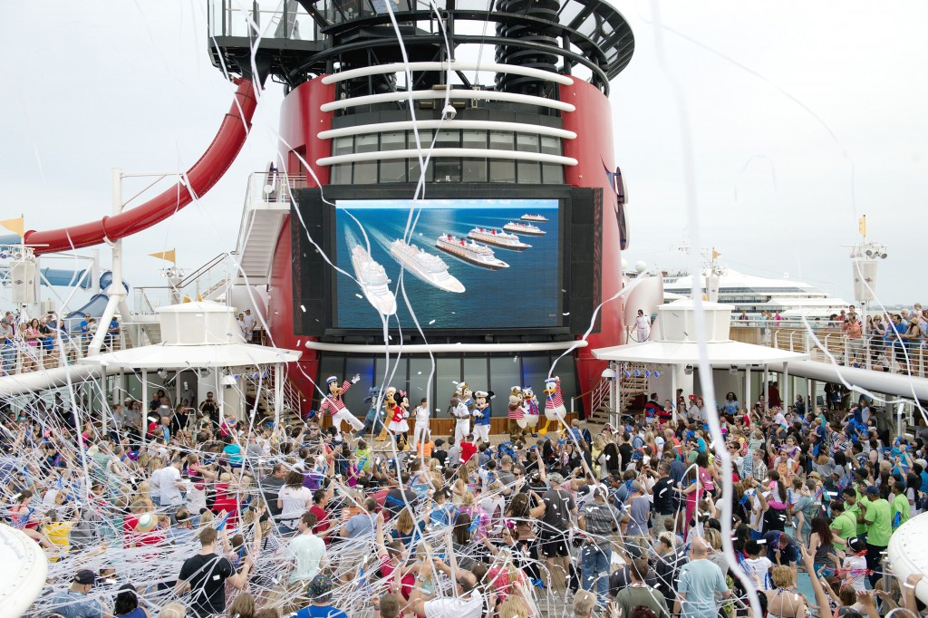 Following The Walt Disney Company announcement to build two additional cruise ships earlier today, Disney Cruise Line celebrated with guests onboard the Disney Magic during a very special Sail Away Party. The schedule calls for the new ships to be completed in 2021 and 2023. Each ship will be approximately 135,000 gross tons – slightly larger than the newest Disney Cruise Line ships, the Disney Dream and Disney Fantasy – and each is currently planned to include about 1,250 guest staterooms. (Chloe Rice, photographer)